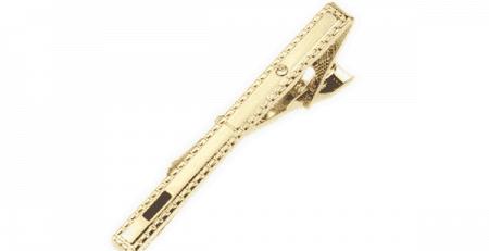 guld slipsenålens placering