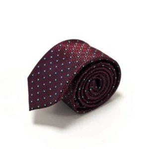sammenrullet detaljefyldt rødt slips