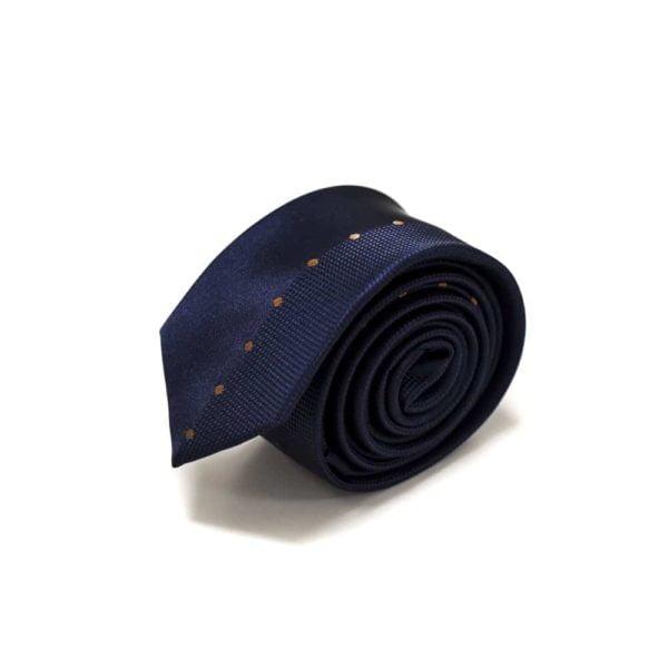 marineblå slips med bronze prikker langs midten